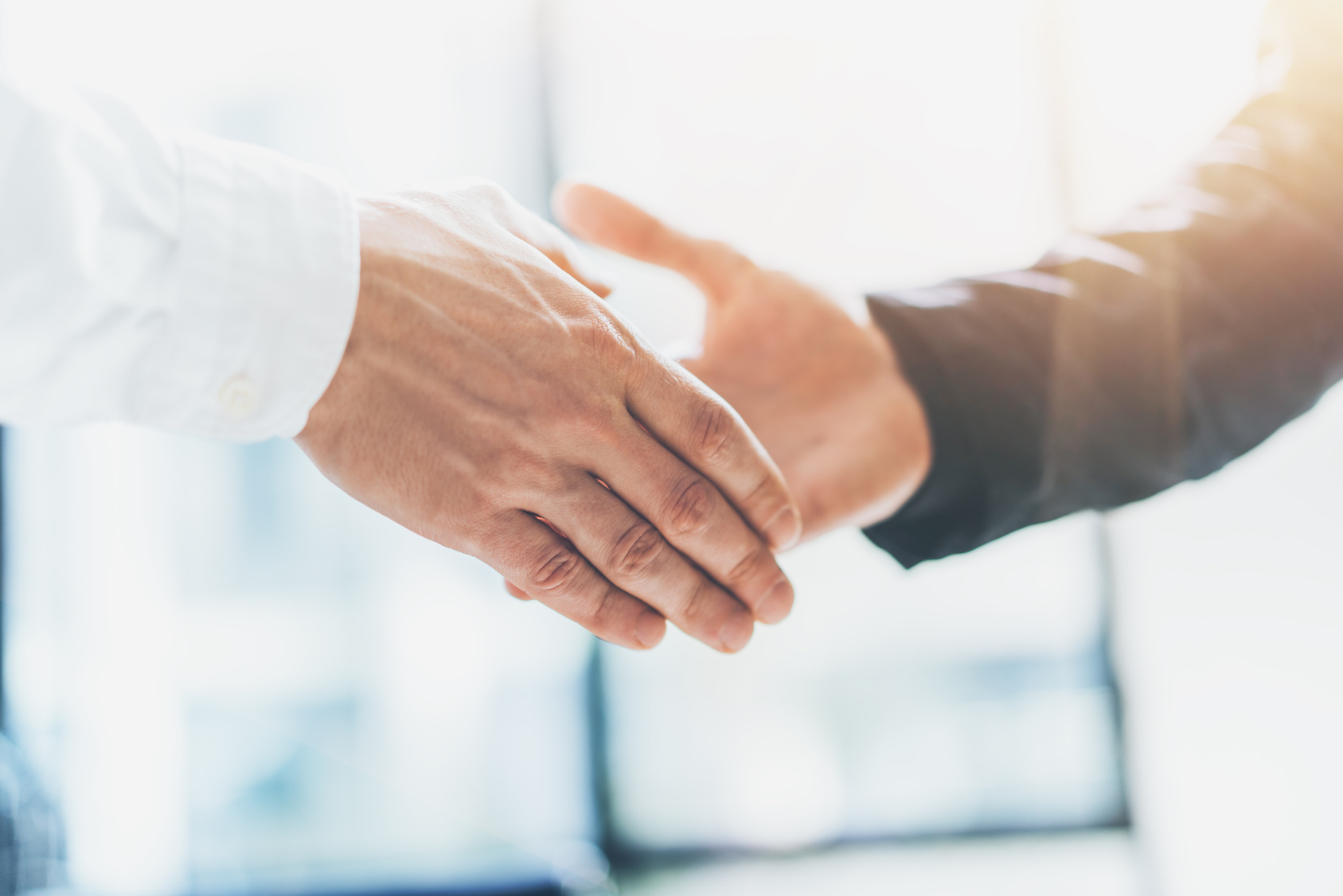 Business partnership meeting. Photo businessmans handshake. Successful businessmen handshaking after good deal. Horizontal, blurred background